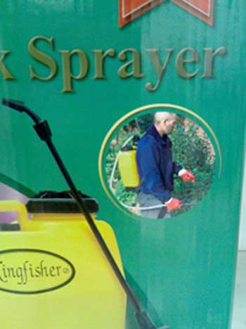 Close up view of knapsack sprayer in use