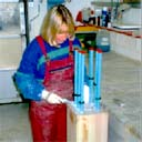 Kathy, at Property Repair Systems, inserting steel bars into a Timber Resin Splice beam