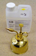 Miniature brass plant sprayer for use in injecting woodworm holes in furniture using Boron Ultra 12 at 5% in water.